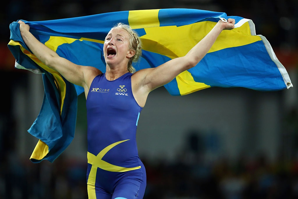 Wrestling swedish women holding swedish flag