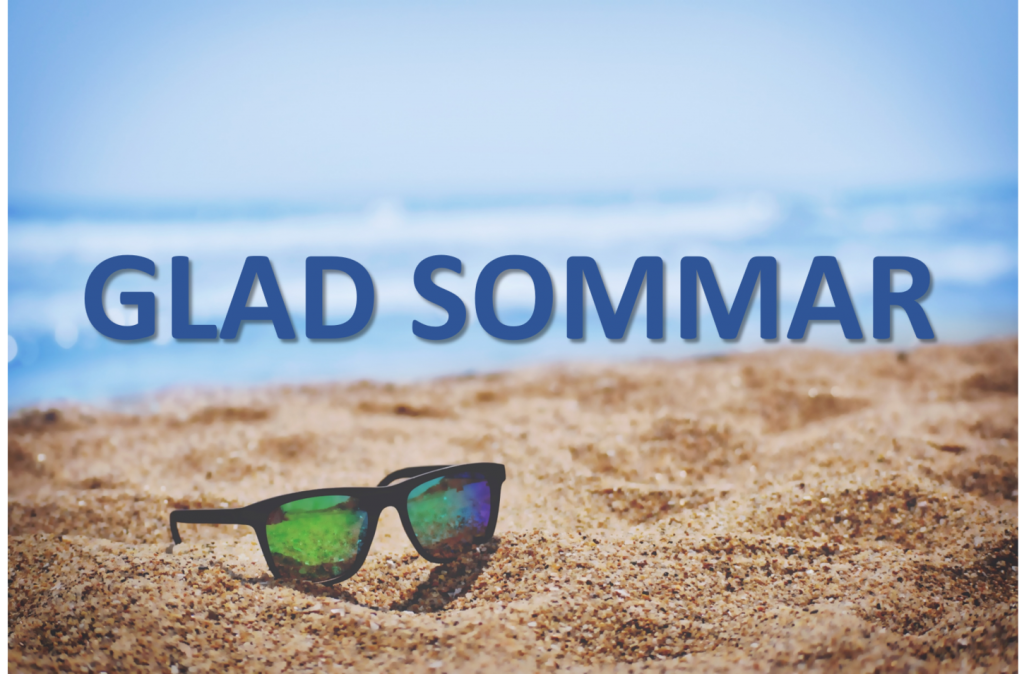 sunglasses on the sand with sea as background